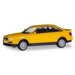 Audi coupé Quattro (B3 - 1991) jaune avec plaques d'immatriculations