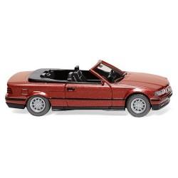 BMW 325i (E36 - 1990)  Cabriolet ouvert rouge vin métallisé