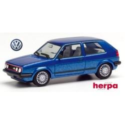 VW Golf Gi II (version 1985 - 4 phares) bleu métallisé avec baguettes latérales noires et jantes sport blanches