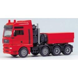 MAN TGA XXL Tracteur lourd 8x4 rouge avec gueuse bâchée
